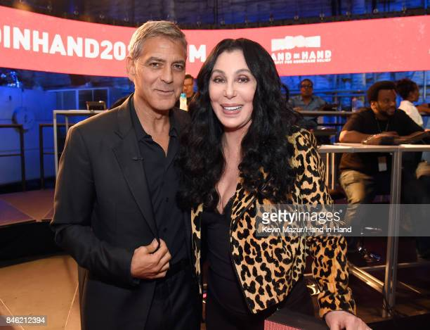 In this handout photo provided by Hand in Hand George Clooney and Cher attend Hand in Hand A Benefit for Hurricane Relief at Universal Studios AMC on...