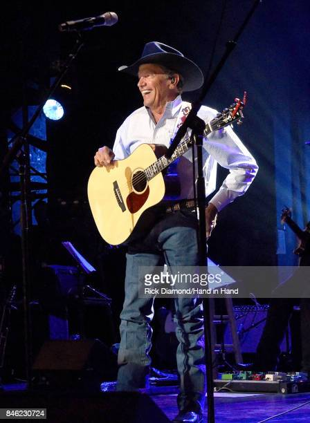 In this handout photo provided by Hand in Hand, George Strait performs onstage during George Strait's Hand in Hand Texas benefit concert; Strait and...
