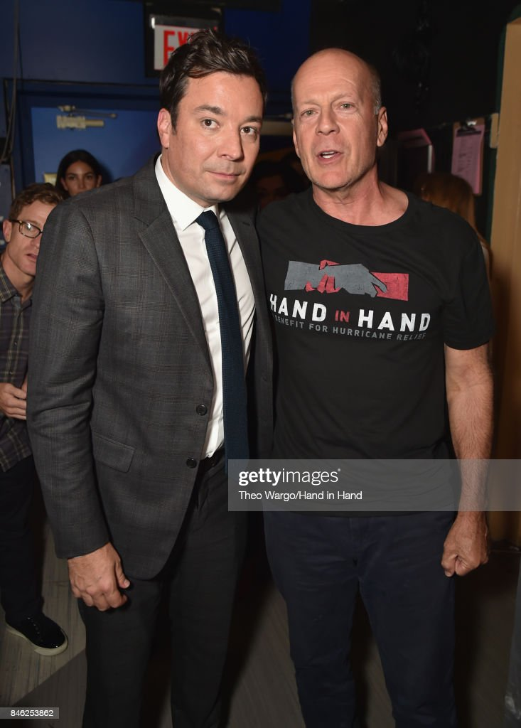 In this handout photo provided by Hand in Hand, Jimmy Fallon and Bruce Willis caption at ABC News' Good Morning America Times Square Studio on September 12, 2017 in New York City.
