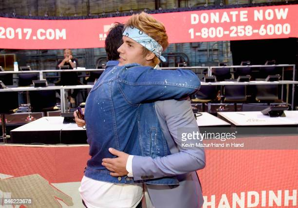 In this handout photo provided by Hand in Hand Joe Jonas and Justin Bieber attend Hand in Hand A Benefit for Hurricane Relief at Universal Studios...