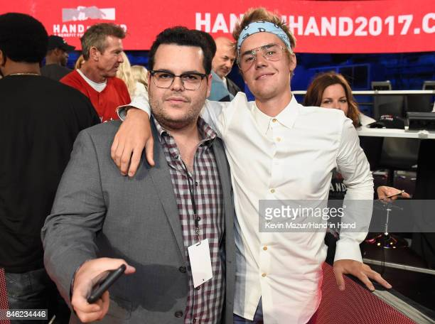 In this handout photo provided by Hand in Hand Josh Gad and Justin Bieber attend Hand in Hand A Benefit for Hurricane Relief at Universal Studios AMC...