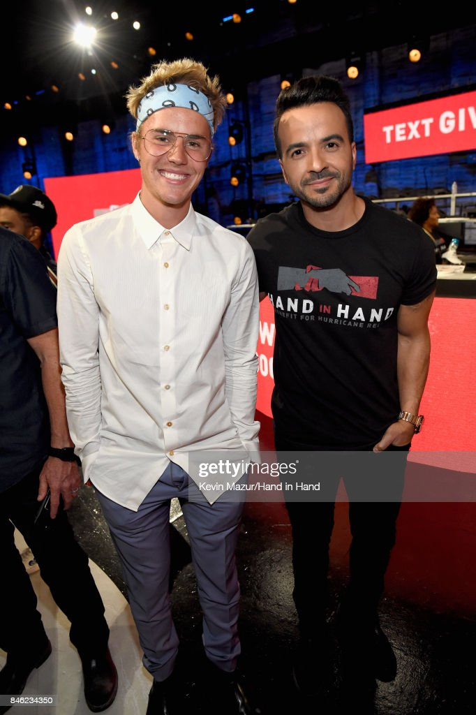 In this handout photo provided by Hand in Hand, Justin Bieber and Luis Fonsi attend Hand in Hand: A Benefit for Hurricane Relief at Universal Studios AMC on September 12, 2017 in Universal City, California.