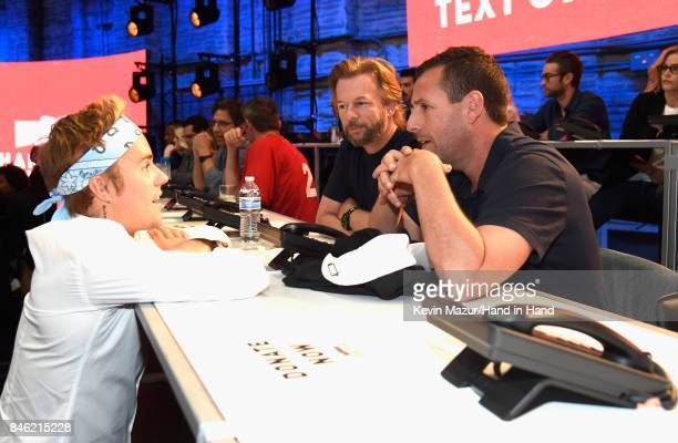 In this handout photo provided by Hand in Hand Justin Bieber David Spade and Adam Sandler attend Hand in Hand A Benefit for Hurricane Relief at...