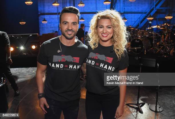 In this handout photo provided by Hand in Hand Luis Fonsi and Tori Kelly attend Hand in Hand A Benefit for Hurricane Relief at Universal Studios AMC...