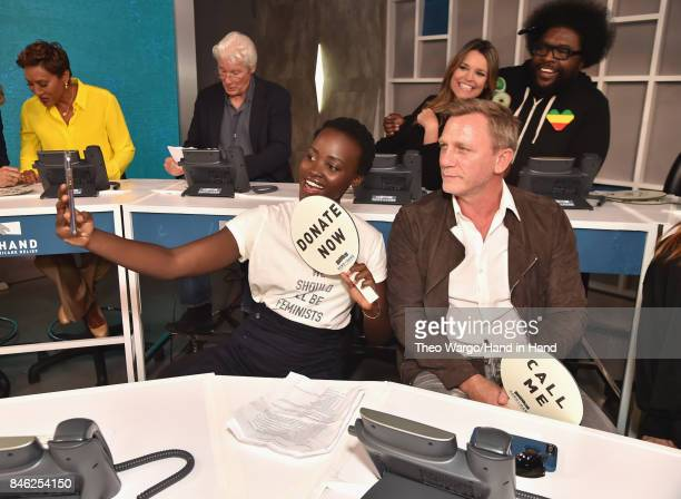In this handout photo provided by Hand in Hand, Lupita Nyong'o and Daniel Craig caption at ABC News' Good Morning America Times Square Studio on...