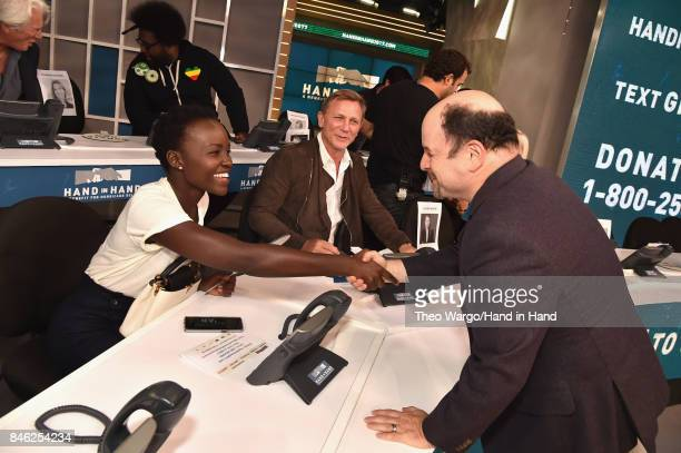 In this handout photo provided by Hand in Hand, Lupita Nyong'o, Daniel Craig and Jason Alexander caption at ABC News' Good Morning America Times...