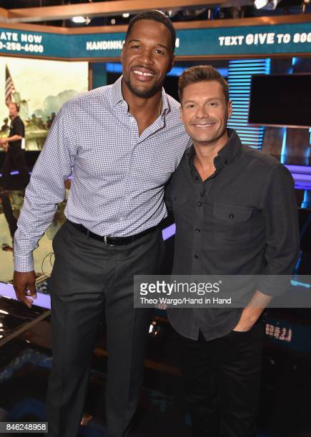 In this handout photo provided by Hand in Hand, Michael Strahan and Ryan Seacrest caption at ABC News' Good Morning America Times Square Studio on...