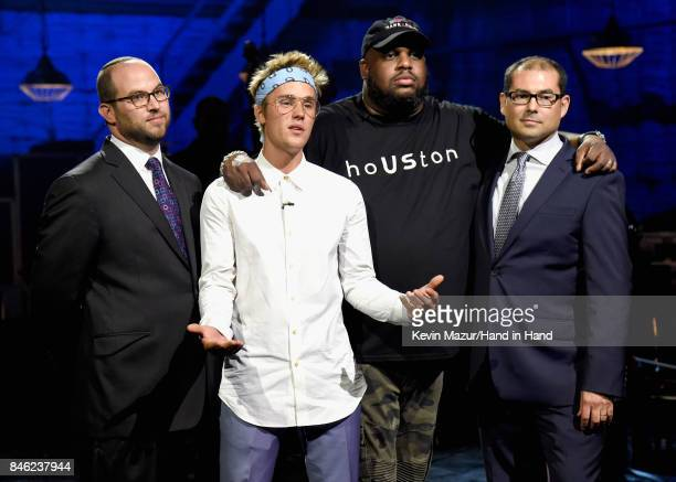 In this handout photo provided by Hand in Hand Rabbi Ari Lukas Justin Bieber Pastor John Gray and Jihad Turk attend Hand in Hand A Benefit for...