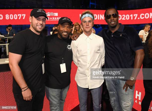 In this handout photo provided by Hand in Hand Scooter Braun Bun B Justin Bieber and Sean 'Diddy' Combs attend Hand in Hand A Benefit for Hurricane...