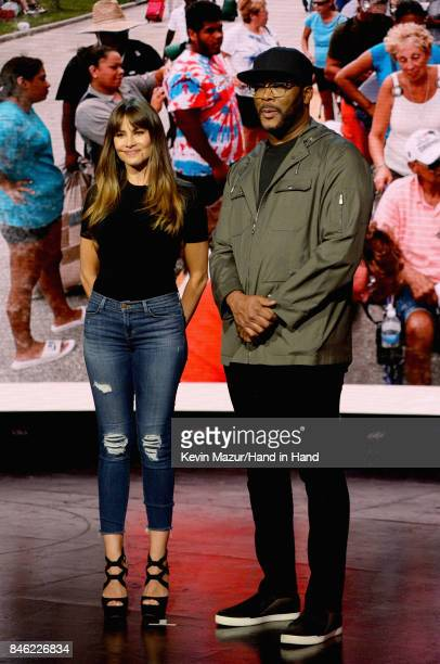 In this handout photo provided by Hand in Hand Sofia Vergara and Tyler Perry attend Hand in Hand A Benefit for Hurricane Relief at Universal Studios...