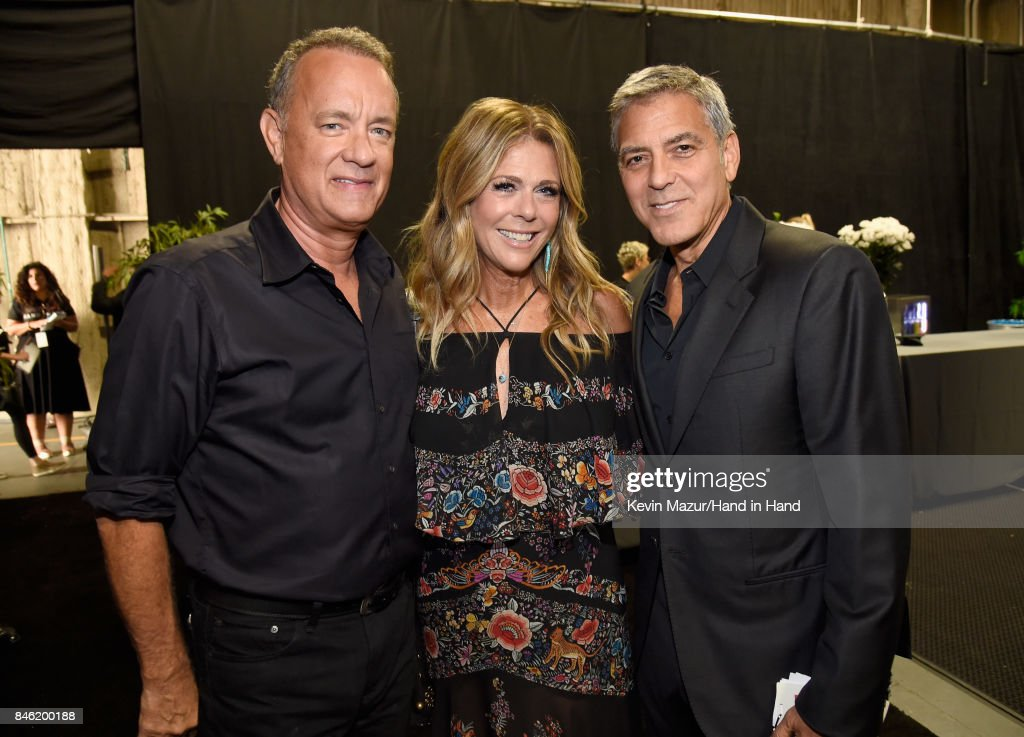 In this handout photo provided by Hand in Hand, Tom Hanks, Rita Wilson and George Clooney attend Hand in Hand: A Benefit for Hurricane Relief at Universal Studios AMC on September 12, 2017 in Universal City, California.