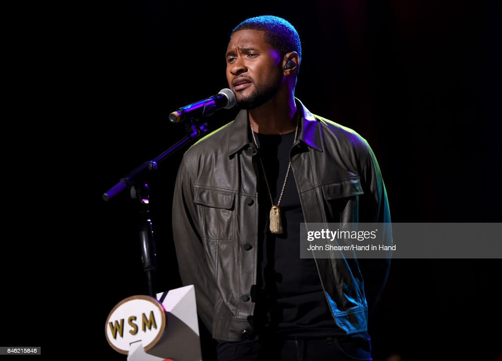 In this handout photo provided by Hand in Hand, Usher performs onstage during Hand in Hand: A Benefit for Hurricane Relief at the Grand Ole Opry House on September 12, 2017 in Nashville, Tennessee.