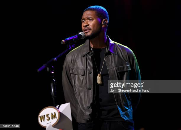 In this handout photo provided by Hand in Hand Usher performs onstage during Hand in Hand A Benefit for Hurricane Relief at the Grand Ole Opry House...