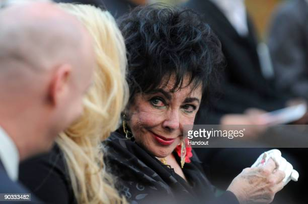 In this handout photo provided by Harrison Funk/The Jackson Family Actress Elizabeth Taylor attends Michael Jackson's funeral service held at...