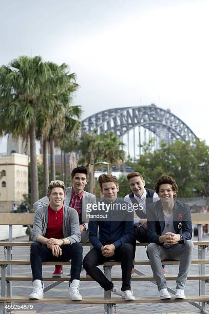 In this handout photo provided by Hausmann Communications One Direction wax figures from Madame Tussauds are seen at Circular Quay on December 12...