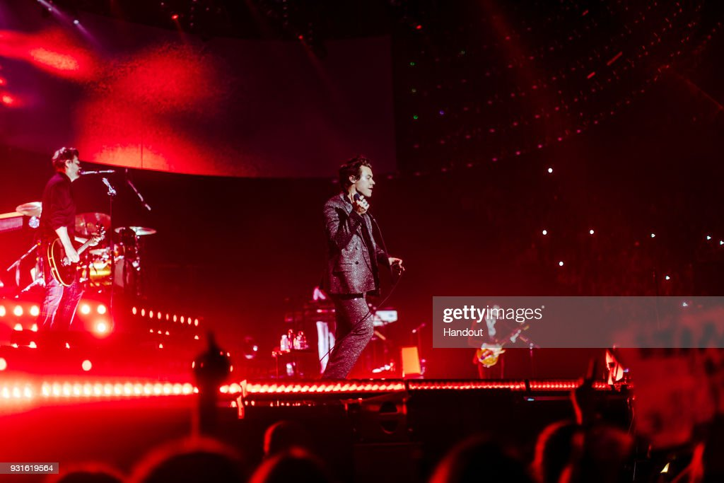In this handout photo provided by Helene Marie Pambrun, Harry Styles performs during his European tour at AccorHotels Arena on March 13, 2018 in Paris, France.