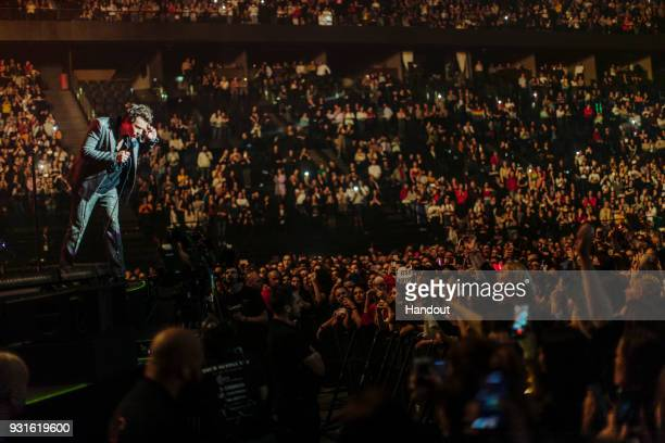 In this handout photo provided by Helene Marie Pambrun Harry Styles performs during his European tour at AccorHotels Arena on March 13 2018 in Paris...