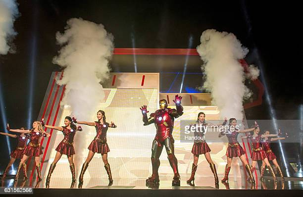 In this handout photo provided by Hong Kong Disneyland Iron Man and His Ironnettes perform during the grand opening of Iron Man Experience presented...