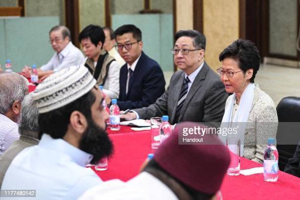 In this handout photo provided by Hong Kong's Information Services Department, Chief Executive Carrie Lam meets with representatives of the...