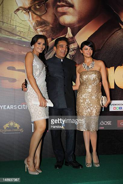 In this handout photo provided by IIFA Andrea Jeremiah Kamal Hassan and Pooja Kumar attend Day One of the IIFA Awards on June 7 2012 in Singapore