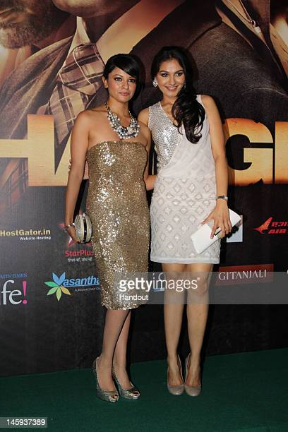 In this handout photo provided by IIFA Pooja Kumar and Andrea Jeremiah attend Day One of the IIFA Awards on June 7 2012 in Singapore