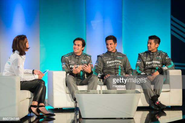 In this handout photo provided by Jaguar Racing Amanda Stretton interviews drivers Nelson Piquet Jr Mitch Evans and HoPin Tung during the Panasonic...
