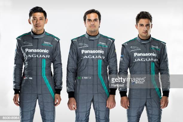 In this handout photo provided by Jaguar Racing Drivers HoPin Tung Nelson Piquet Jr and Mitch Evans pose during the Panasonic Jaguar Racing RECHARGE...