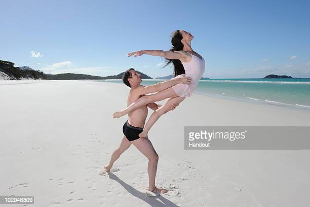 In this handout photo provided by James Morgan on behalf of Hamilton Island Australian ballet dancers rehearse their moves on Whitehaven Beach on...