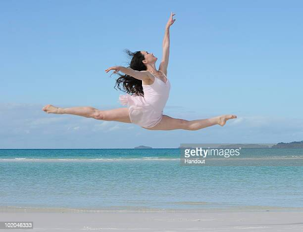 In this handout photo provided by James Morgan on behalf of Hamilton Island an Australian ballet dancer rehearses moves on Whitehaven Beach on June...