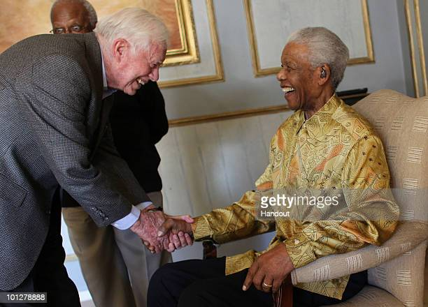 In this handout photo provided by Jeff Moore Nelson Mandela is reunited with Jimmy Carter as other members of the Edlers watch on May 29 2010 in...