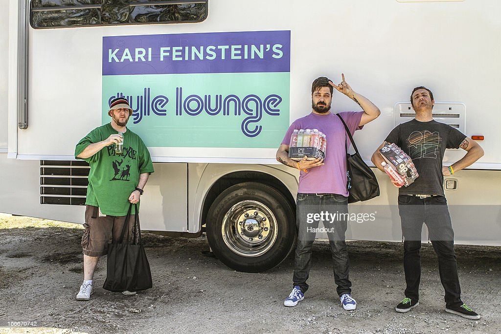 In this handout photo provided by Kari Feinstein PR, Aesop Rock carrying Sparkling Ice and Afterparty attends the Kari Feinstein's style lounge on the road in the desert April 14, 2013 near Indio, California.