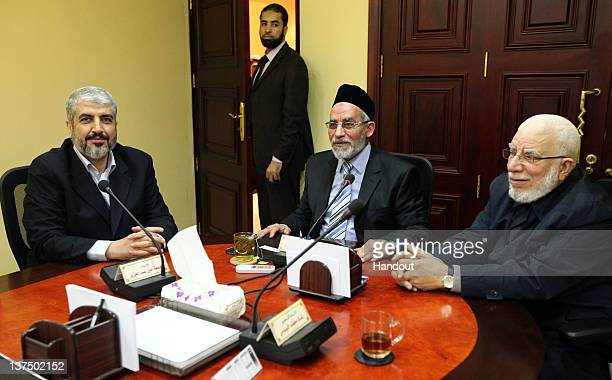In this handout photo provided by Khaled Meshaal's Office of Media, the leader of Hamas Khaled Meshaal meets with Supreme Leader of the Muslim...