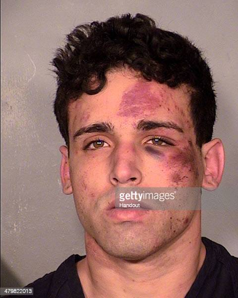 In this handout photo provided by Las Vegas Metropolitan Police Department Joey Kadmiri poses for a booking photo at the Las Vegas Police Department...