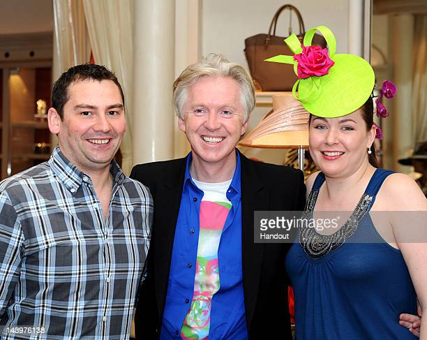 In this handout photo provided by Las Vegas News Bureau Milliner Philip Treacy poses with newlyweds Conor Cruise and Irene Cruise of Ireland at Bags...