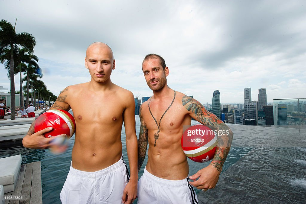 In this handout photo provided by Marina Bay Sands, Jonjo Shelvey and Raul Meireles of Liverpool FC pose at the iconic Sands SkyPark, Marina Bay Sands on July 18, 2001 in Singapore.