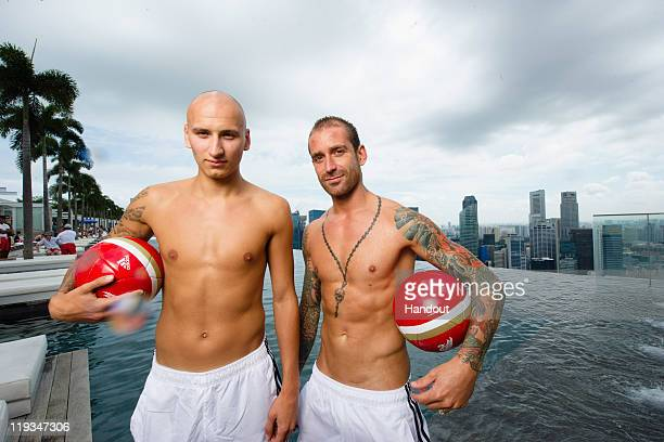 In this handout photo provided by Marina Bay Sands Jonjo Shelvey and Raul Meireles of Liverpool FC pose at the iconic Sands SkyPark Marina Bay Sands...