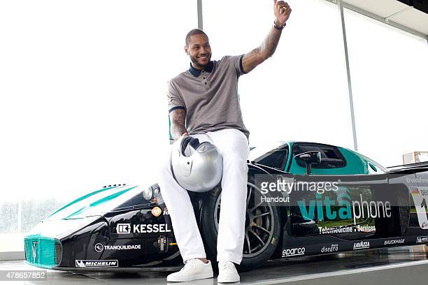 In this handout photo provided by Maserati Carmelo Anthony with the Maserati MC12 June 16 2015 at Balocco Circuit Italy New York Knicks basketball...