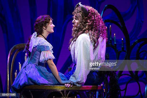 In this handout photo provided by Matthew Murphy/NETworks Brooke Quintana as Belle and Sam Hartley as the Beast in Disney's Beauty and the Beast...