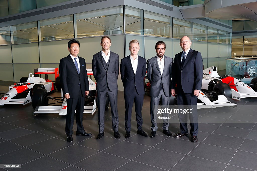 In this handout photo provided by McLaren-Honda, Formula One drivers Fernando Alonso (2nd R) and Jenson Button (2nd L) pose as McLaren-Honda announces its new driver line-up for 2015 with Kevin Magnussen (C) who will remain as test and reserve driver, as Ron Dennis (R), Chairman & Chief Executive Officer, McLaren and Yasuhisa Arai (L), Senior Managing Officer, Honda R&D Co Ltd; Chief Officer of Motorsport, Honda pose with them on December 10, 2014 in Woking, England.