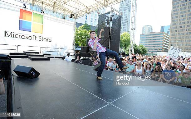 In this handout photo provided by Microsoft 'American Idol' season 10 winner Scotty McCreery performs for fans in celebration of the opening of the...