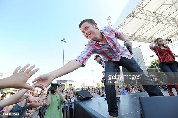 In this handout photo provided by Microsoft 'American Idol' season 10 winner Scotty McCreery greets fans after performing in celebration of the...