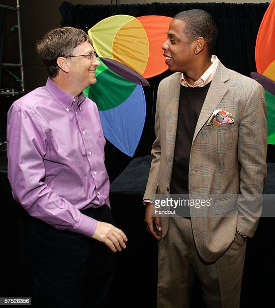In this handout photo provided by Microsoft Corp Microsoft Chairman Bill Gates and Shawn JayZ Carter president and CEO of Def Jam Recordings greet...