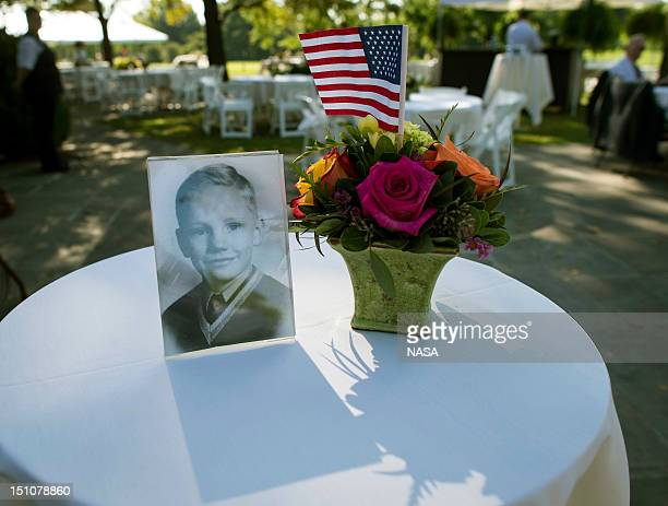 In this handout photo provided by NASA a photograph of Neil Armstrong as a young man is displayed on a table during a memorial service celebrating...