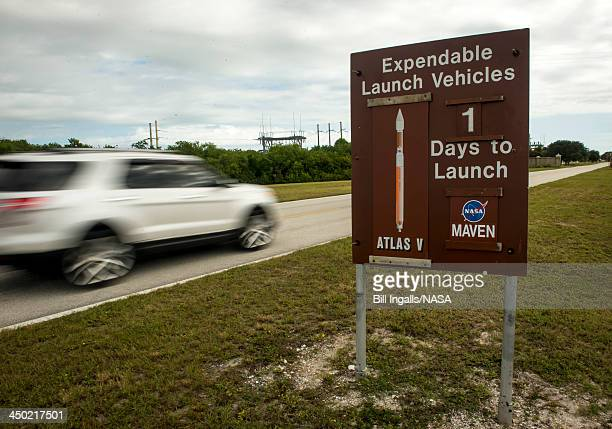 In this handout photo provided by NASA, a sign along the NASA Kennedy Space Center causeway displays to passersby that there is one day remaining...