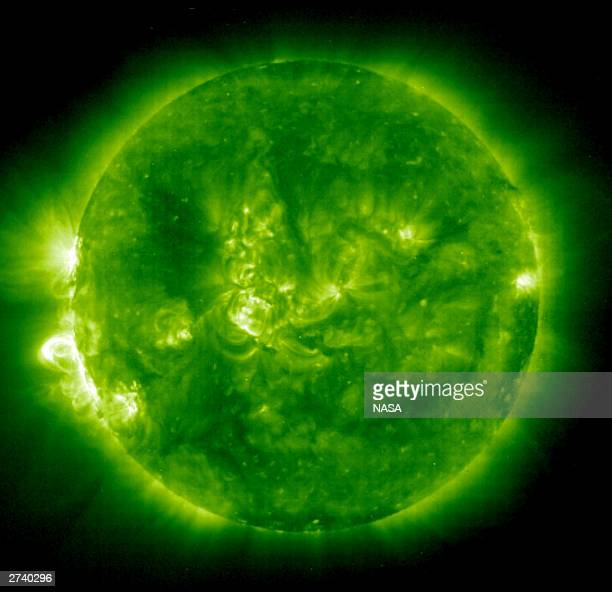 In this handout photo provided by NASA a Solar and Heliospheric Observatory image shows Region 486 that unleashed a record flare last week November...