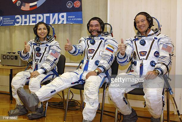 In this handout photo provided by NASA American businesswoman Anousheh Ansari Soyuz Commander and Expedition Flight Engineer Mikhail Tyurin and...