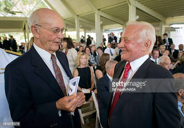In this handout photo provided by NASA Apollo 11 Astronauts Michael Collins and Buzz Aldrin talk at a private memorial service celebrating the life...