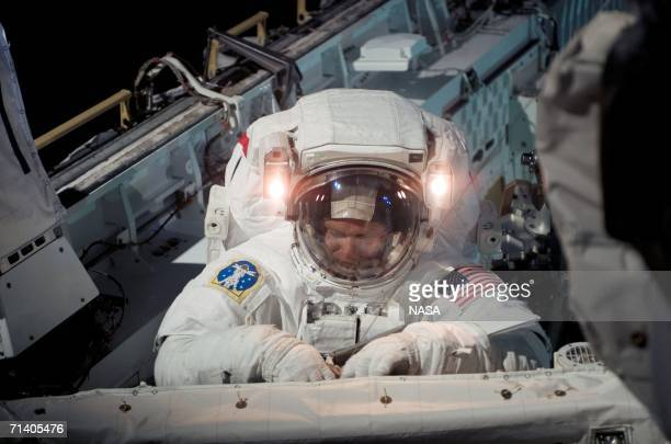 In this handout photo provided by NASA, astronaut Piers J. Sellers, STS-121 mission specialist, works on a section of the International Space Station...