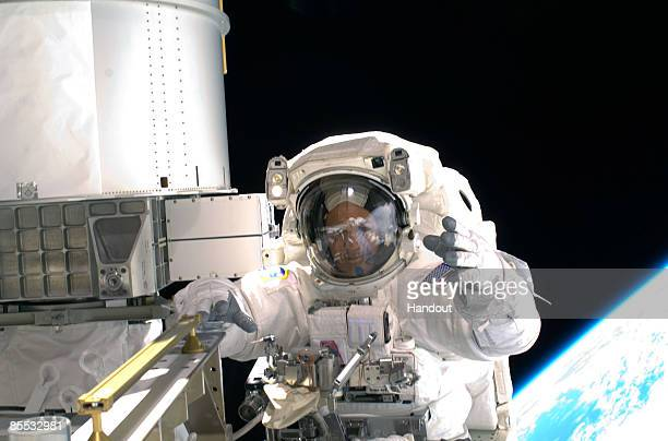 In this handout photo provided by NASA Astronaut Richard Arnold STS119 mission specialist participates in the mission's first scheduled session of...