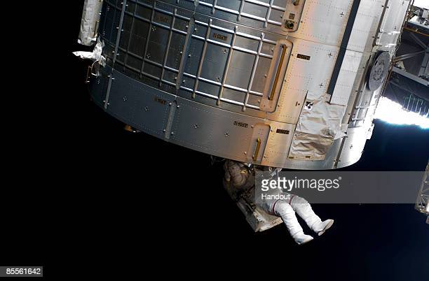 In this handout photo provided by NASA Astronaut Steve Swanson STS119 mission specialist participates in the mission's second scheduled session of...